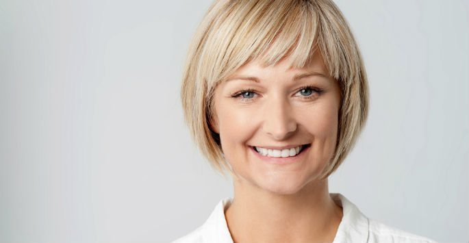 Smiling woman after skin tightening