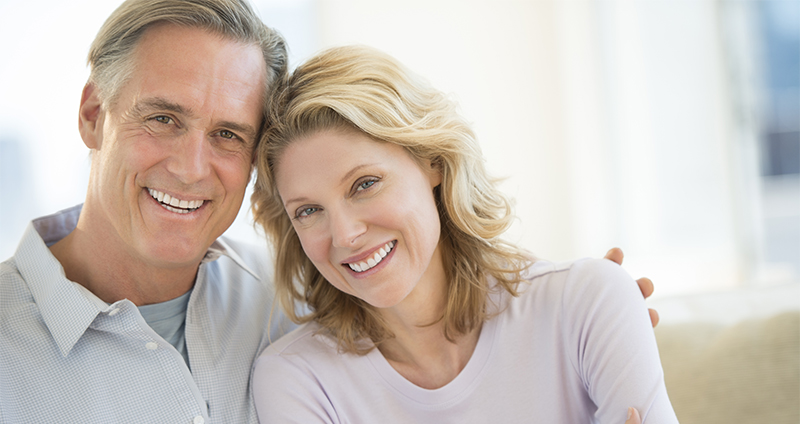couple holding each other and smiling