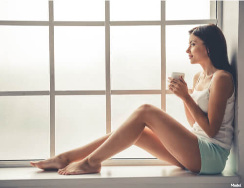A woman relaxing by a window