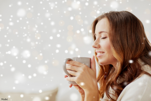 Woman drinking a cup of hot coffee