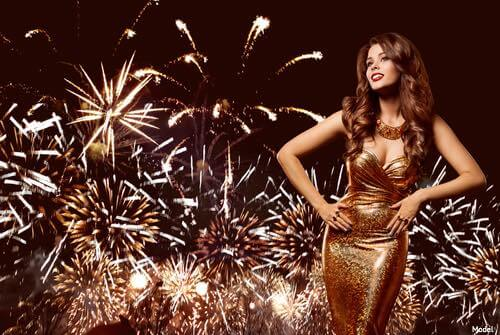 Woman with fireworks behind her