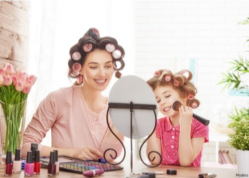 mom and daughter doing their hair together